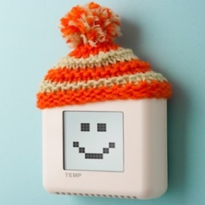 Digital room temperature thermostat with smiley face and wooly hat